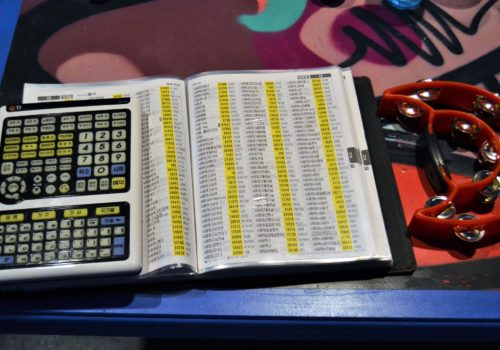 open notebook beside tambourine