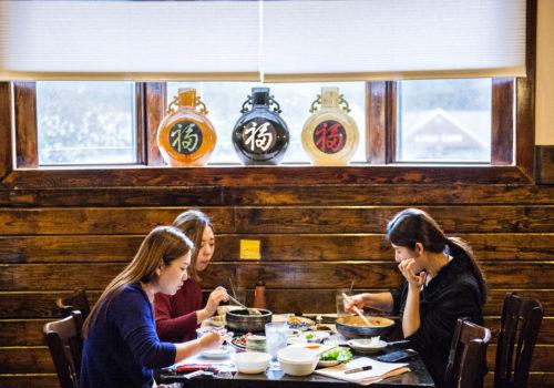 three people eating