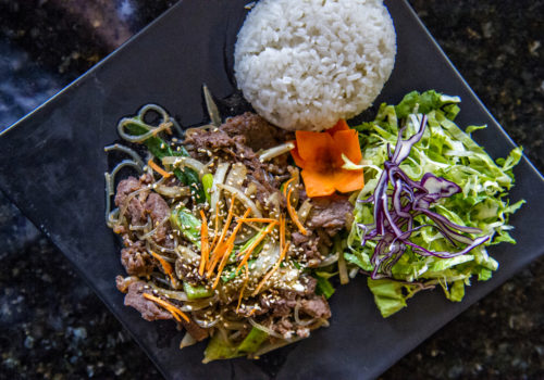 plate of beef, rice and vegetables