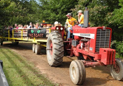 tractor pulling wagon of people