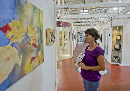 woman looking at art on wall