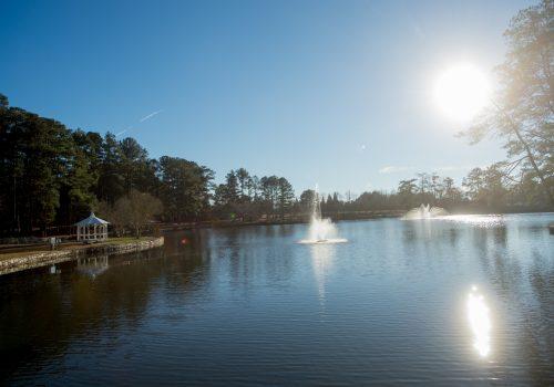sun over lake at Briscoe Park
