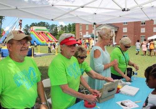 volunteers in green shirts