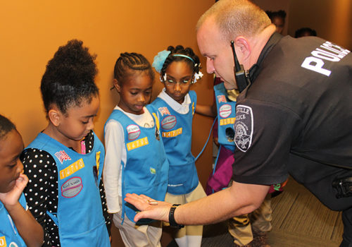 police officer and group of children