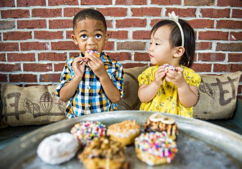 kids eating doughnuts