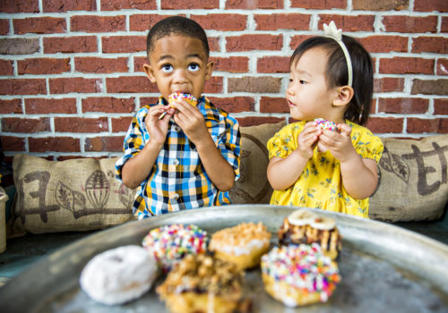 kids eating doughnuts