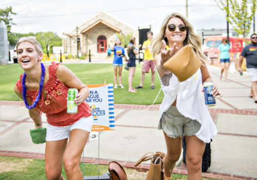 women playing cornhole