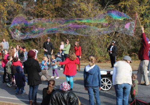 man blowing large bubble