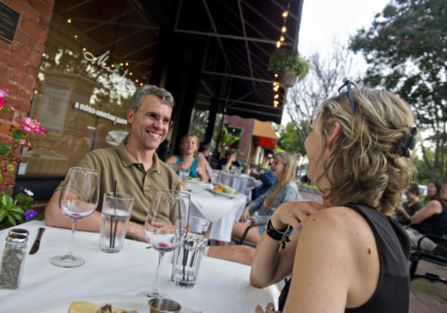 couple at table laughing