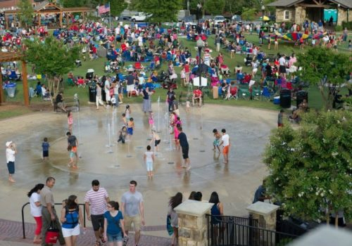people playing in fountain