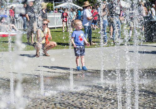 boy running through fountain