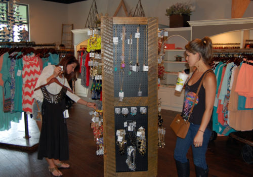 women looking at jewelry for sale