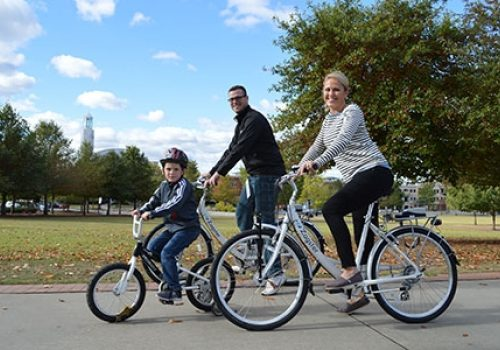 family riding bicyles