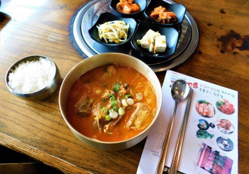 bowl of soup with side dishes