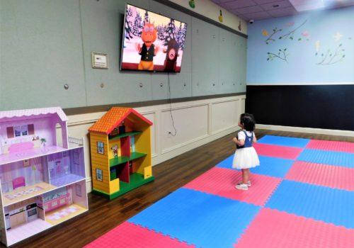 little girl watching TV cartoon
