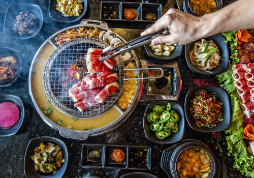 person cooking Korean BBQ