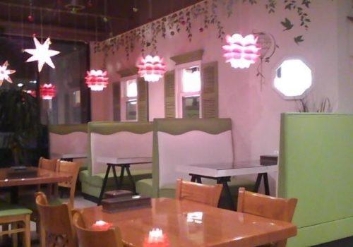 pink lights over restaurant booths