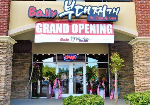 restaurant grand opening sign