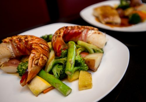lobster tail and vegetables