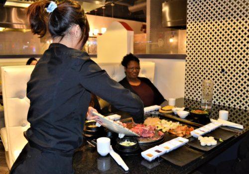 server making Korean BBQ
