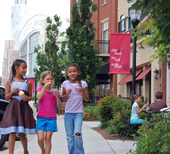 Girls ice cream walking