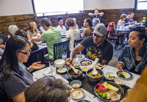 people in restaurant enjoying food