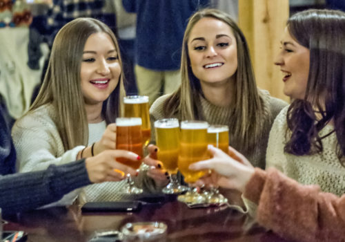 group of girls toasting glasses
