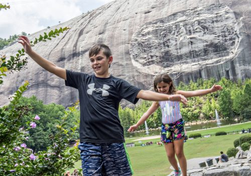two kids in front of Stone Mountain