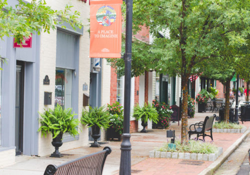 city sidewalk and storefronts