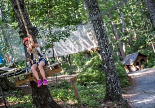 girl on rope swing