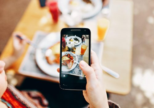phone taking photo of food