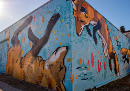 Building mural of foxes playing