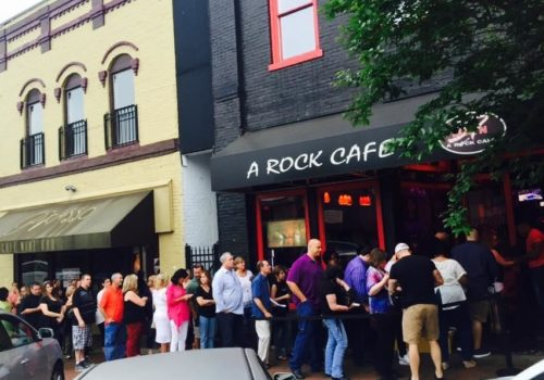 line of people in front of cafe