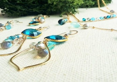 Blue and gold jewelry on table
