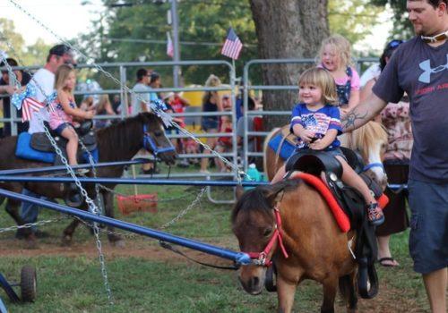 child riding pony