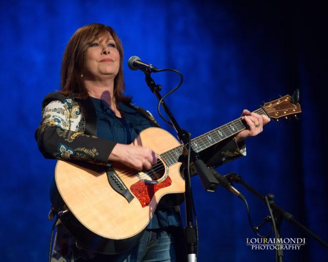 Eddie Owen Presents (woman with guitar on stage)