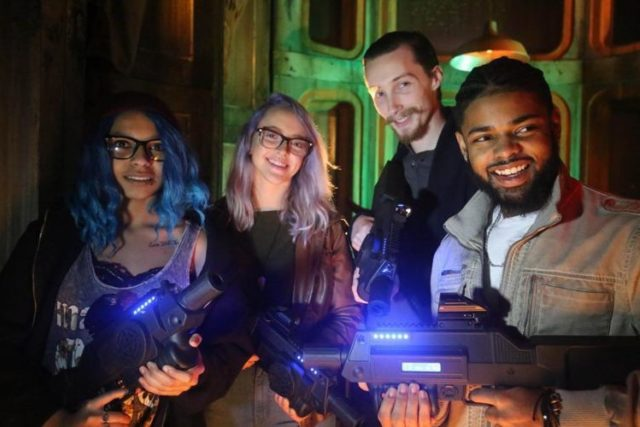 Adults playing laser tag