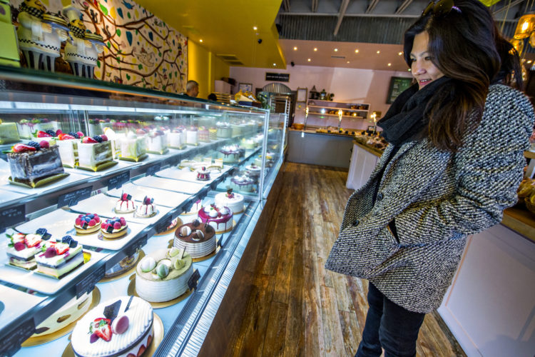 Woman looking at cakes in a bakery